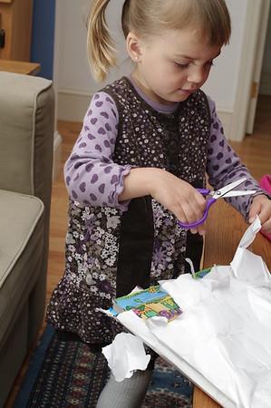 Cutting open a present.
