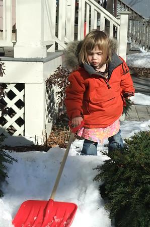 The sidewalk is clear, so Anya makes her own work.