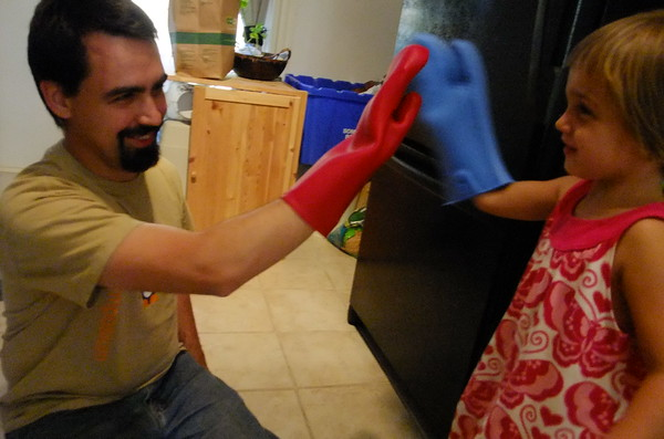 Oven-mitt high-five.