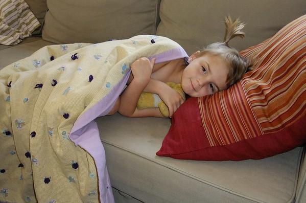 Poor sick Anya cuddles up with Matthew's childhood teddy bear.