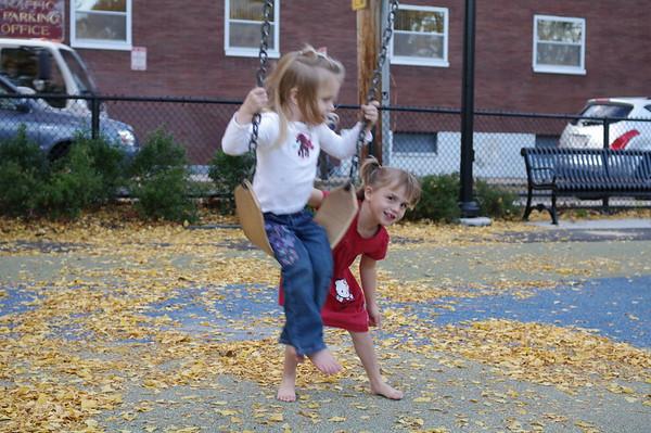Anya gives Lila a push.
