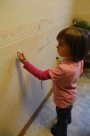 Anya adds to Grandma's wall mural.