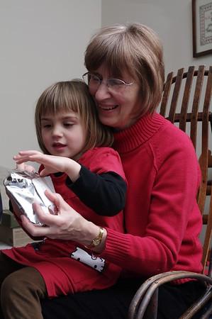 Anya helps with Nana's present.