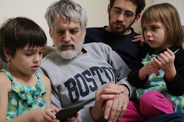 Everyone admires Papa's Kindle.