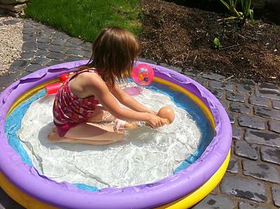 Anya teaches Baby Bunny to swim.