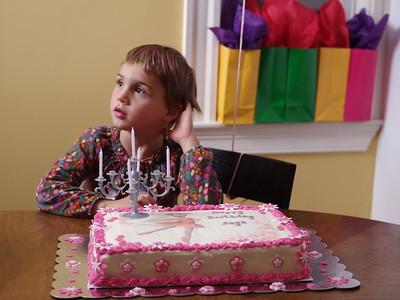 Anya waits for her cake.