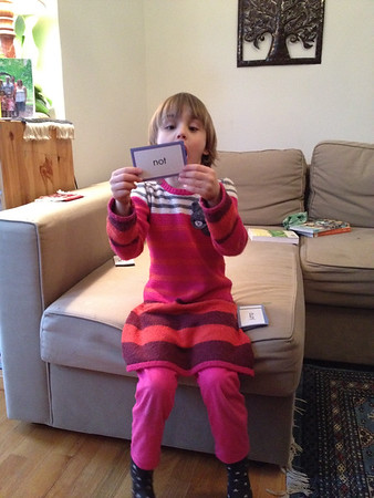 Anya works with her reading flash cards.
