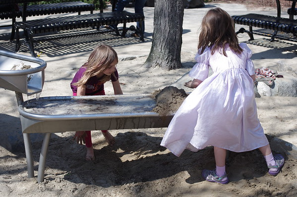 Anya and Sophia in the sand.