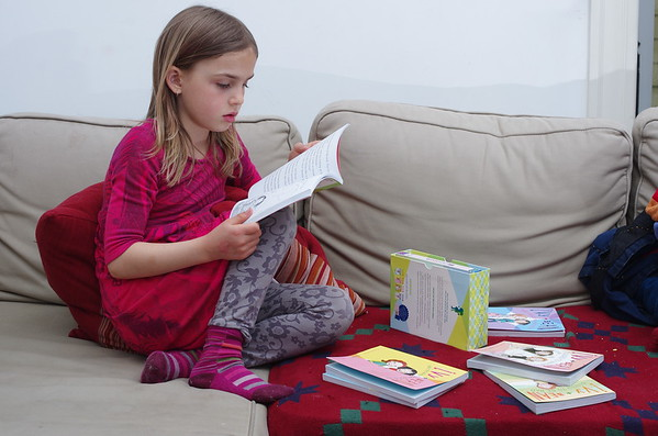 Anya reads Ivy and Bean.