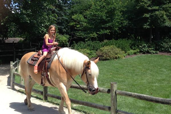Anya on horseback.