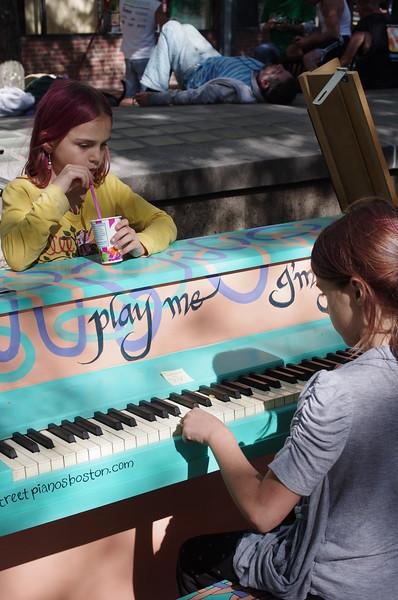 Guen plays the Davis Square piano.