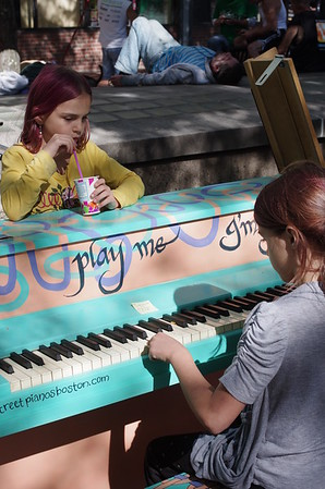 Guen plays the Davis Square piano.