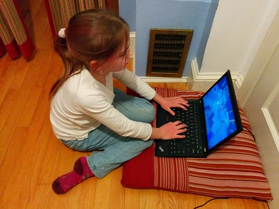 Minecrafting (and keeping warm by the heat vent).
