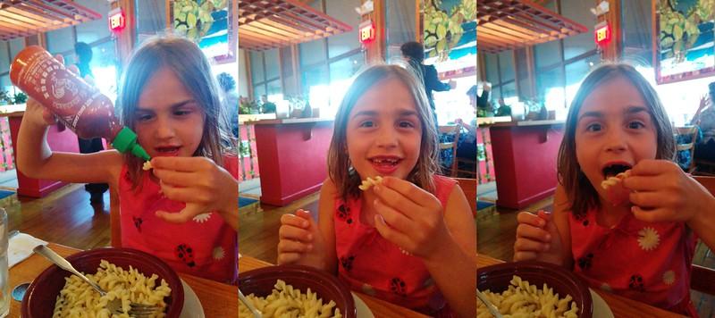 Anya tries a tiny, tiny bit of sriracha on her pasta.