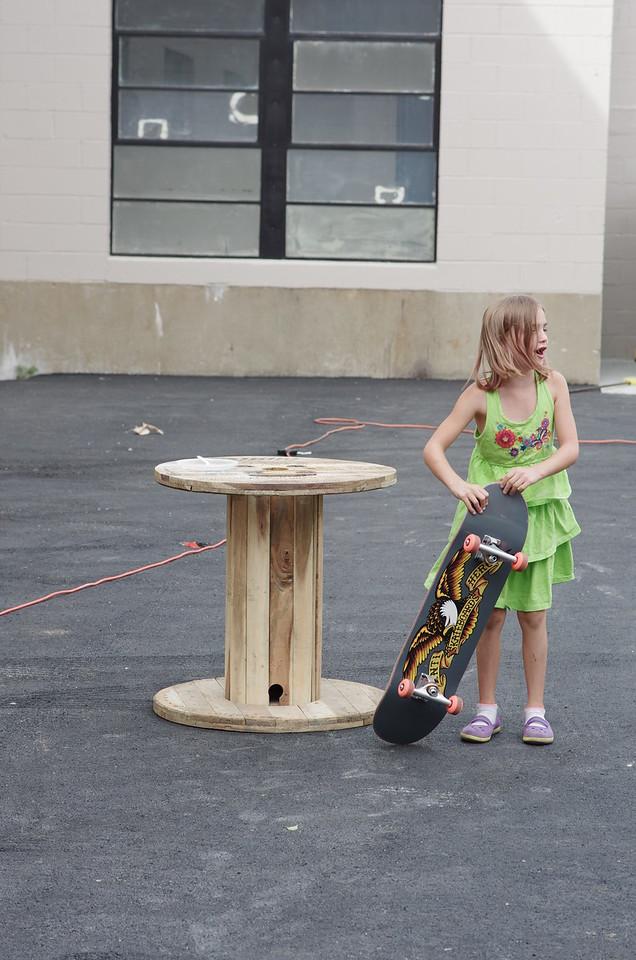 Anya with Guen's skateboard.