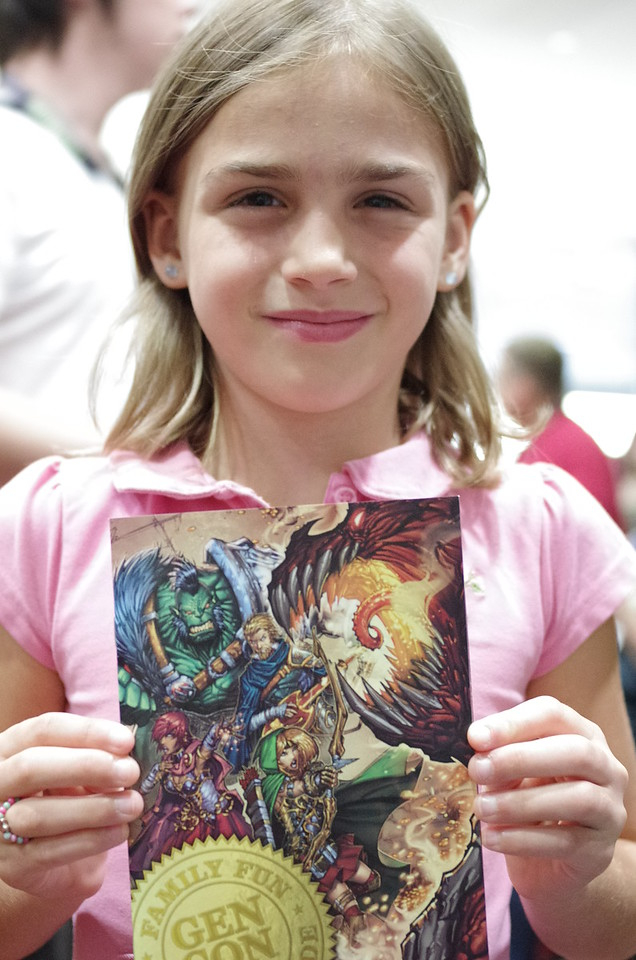 Anya proudly shows her Gen Con pass.