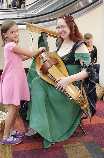 Anya helps with the hurdy-gurdy.