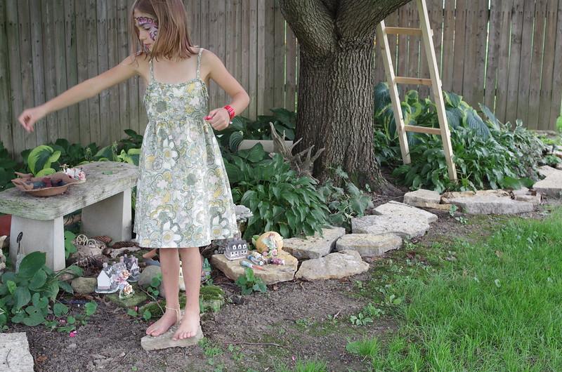 Sprinkling petals over the fairy garden.