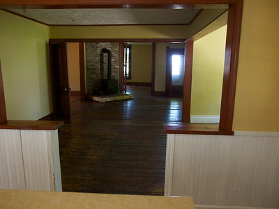 Looking from the kitchen through the dining room, living room and guest bedroom.