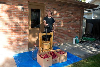 Older son Dan woking at making apple cider.
