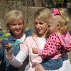 Gram, Mommy, and Hallie feeding the birds