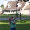 Camden showing off her bird feeder.