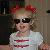 I sure am cool in Daddy's sunglasses!