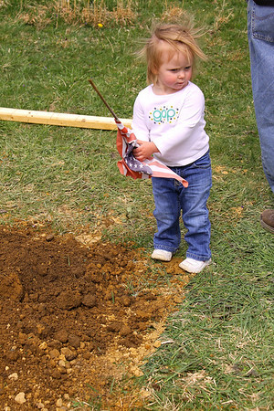 Morgan planting a flag on dad's grave.... looking at this now I think she took it from someone else's grave.  Way to go MO!!!!