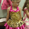 Lena trying on one of her costumes for the June dance recital.  This is for the Lion King dance.  So cute!