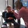 Norah getting her ears pierced!