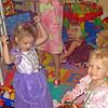 Celia, Elizabeth and Cidney teach Louisa the art of dress-up.