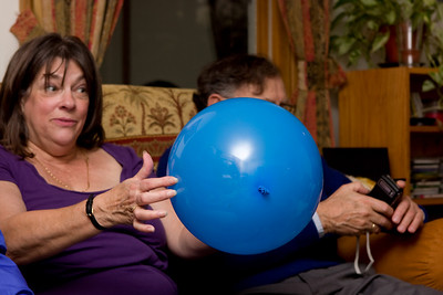 Mom with the big blue balloon.