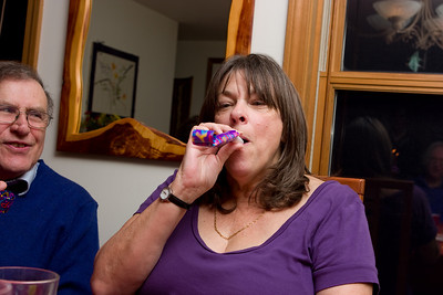 Mom with the party blower.