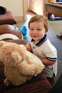 Luke playing with a teddy bear 3-24-12.