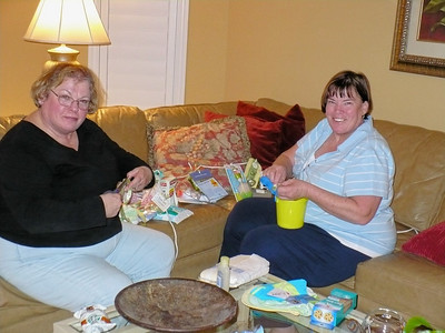 Gloria and Mary Ann prepare a game