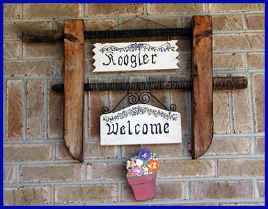 Wilkommen to das Kugler Haus! <br /> I found another use for my grandfathers wood brace. Painted the signs myself. I was inspired by the German hotel we stayed in on a visit to Helen, Ga. The name spelling was changed when the family emigrated to the Shenandoah Valley of Virginia in the early 18th century.