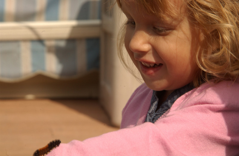 Zara with woolly-bear caterpillar