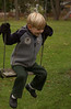 Logan swinging at our house