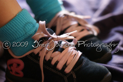 learning to tie her own shoes