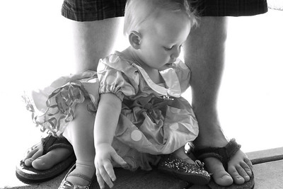 At her Daddy's feet...