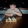 Much learning in this chess pupil I see..  Baxter ponders his next move with his new chess set
