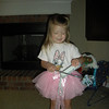 Claire dressing up in the new tutu that Mrs. Robin gave her.