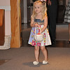 Hallie at practicing being the flower girl at the dress rehersal.