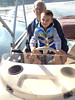 20130819-0937 IMG_6331 Ethan driving boat, Steve