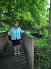 Colleen on the bridge that crosses the little creek at the Hermitage.