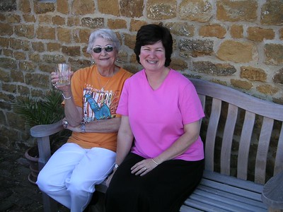 Aunt Blanche with my friend Cindy, on the bench in front of my house in Deddington