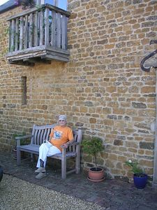 Aunt Blanche, relaxing on the bench in front of my house in Deddington