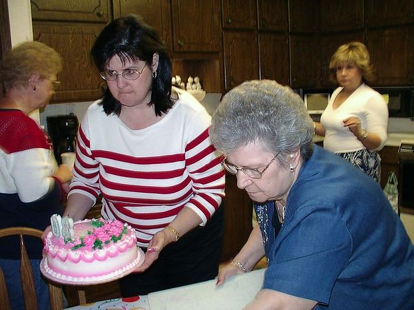 """<br><br><font size=""""3"""">Cutting the cake.</font>"""