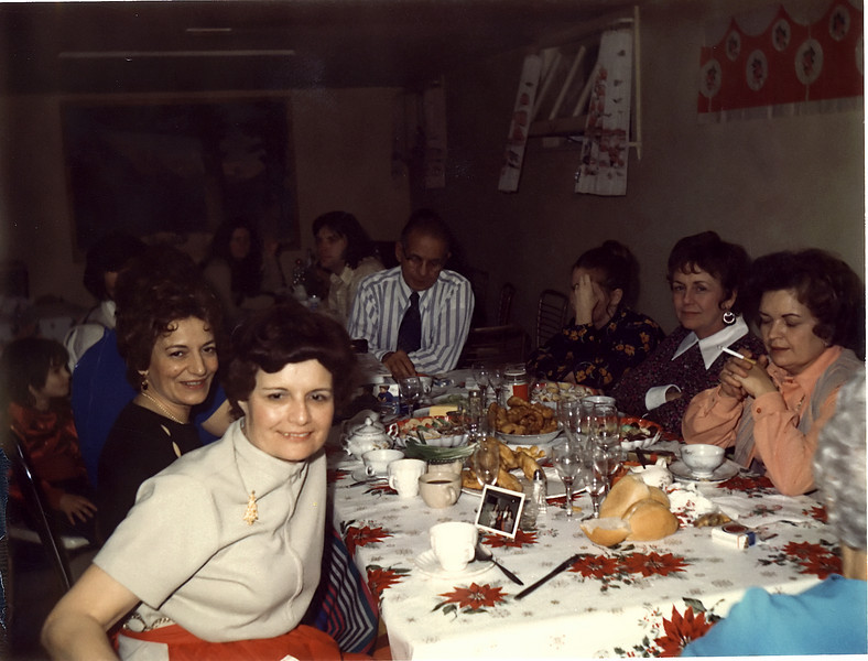 Christmas Eve dinner in Grandma & Grandpa's basement, circa 1971?.  Bernie, Rose, Gram Toots, Tristan, (?), Denny (in background), Grandpa, Lynn (?), Verna, Wanda, Grandma Valco (?)