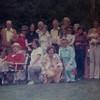 Celebrating WB's 95th Birthday on Bowen Island above the Lagoon.<br /> Back L- John, Red, Teeny Patti, Bill, Paula, John, Lorraine, Bill, Mickey, Eileen, Karlene, George, Jenny, Louise<br /> Front L- Mark, WB, Laura, Joanne, Gen